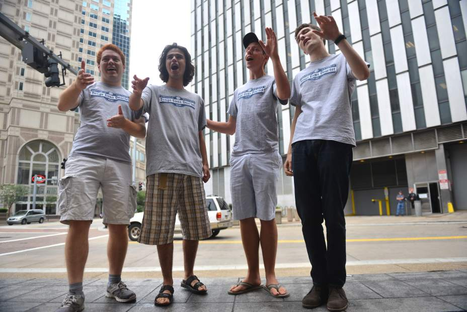 The Yonge Guns Quartet from Toronto, Ontario, Canada (from left) Chris Tanaka-Mann, Reuven Grajner, Greg Mallett and Jonah Lazar perform 'If My Friends Could See Me Now/Hey Look Me Over' medley Tuesday June 30, 2015 on a park bench along Liberty Avenue in Downtown Pittsburgh. Read more: http://triblive.com/aande/music/8652964-74/harmony-barbershop-convention#ixzz3eddKzqig   Photo: James Knox | Trib Total Media