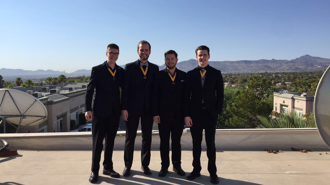 YBQC Third Place medalists Brothers In Arms sing from the the rooftop of Fox5.